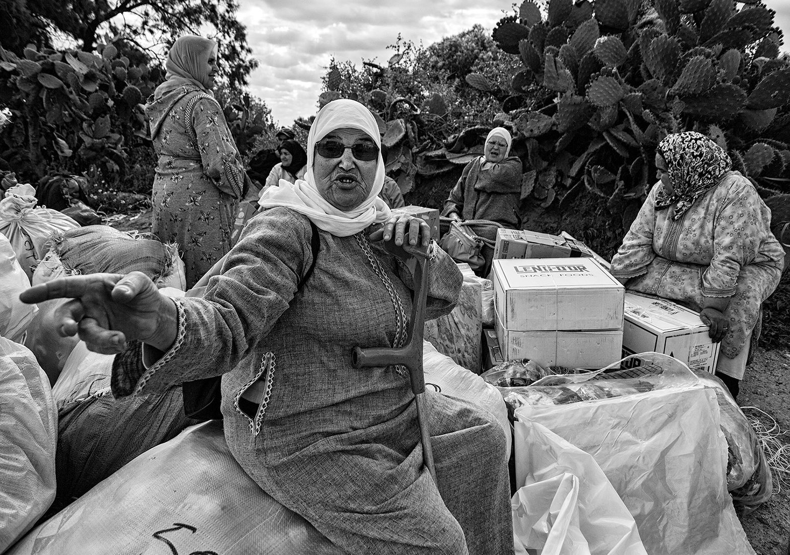 Some women wait for someone to help them load the goods on their backs. This is why often they suffer muscular skeletal disorders, because of the heavy burden, among other adverse health effects Melilla. Spain